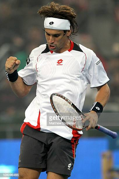 David Ferrer of Spain celebrates a point against Ivan Ljubicic of Croatia during day nine of the 2010 China Open at the National Tennis Center on...