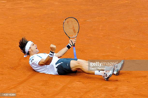 David Ferrer of Spain celebrates after defeating Milos Raonic of Canada during their Semifinal match of the ATP 500 World Tour Barcelona Open Banco...