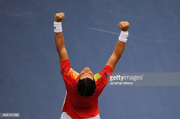 David Ferrer of Spain celebrates after winning a match against Julien Benneteau of France on day 8 of the Western Southern Open at the Linder Family...