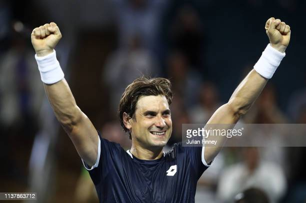David Ferrer of Spain celebrates defeating Alexander Zverev of Germany during the Miami Open Tennis on March 23 2019 in Miami Gardens Florida