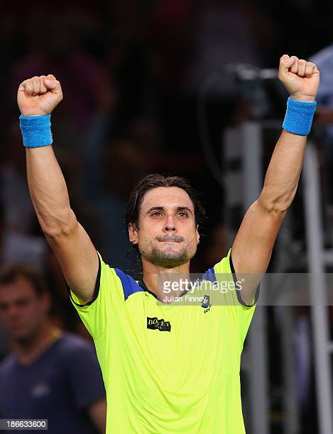 David Ferrer of Spain celebrates defeating Rafael Nadal of Spain during day six of the BNP Paribas Masters at Palais Omnisports de Bercy on November...