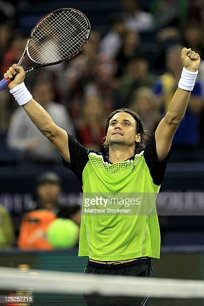 David Ferrer of Spain celebrates his win over Feliciano Lopez of Spain during the semifinals of the Shanghai Rolex Masters at the Qi Zhong Tennis...