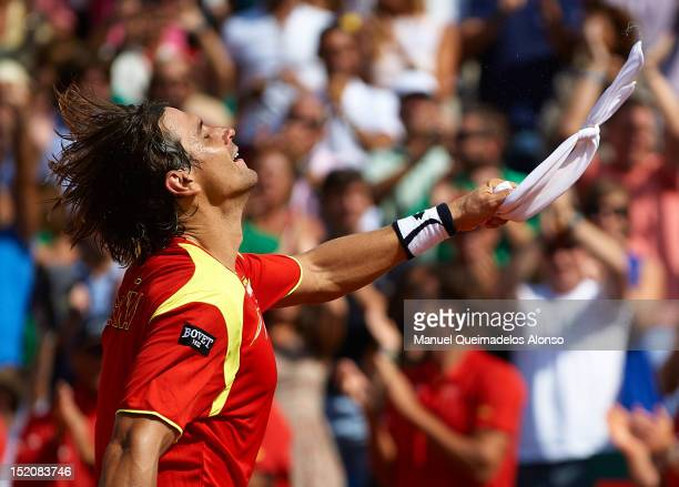 David Ferrer of Spain celebrates his win over John Isner of the United States during day three of the semi final Davis Cup between Spain and the...