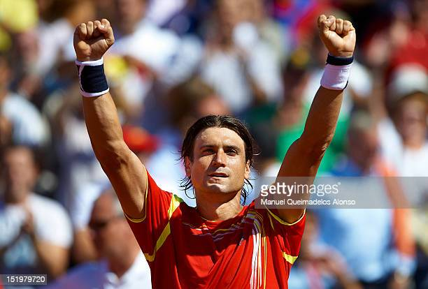 David Ferrer of Spain celebrates his win over Sam Querrey of the United States during day one of the semi final Davis Cup between Spain and the...