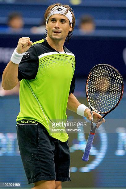 David Ferrer of Spain celebrates match point against Andy Roddick of the United States during the Shanghai Rolex Masters at the Qi Zhong Tennis...