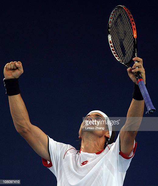 David Ferrer of Spain celebrates match point against Ivan Ljubicic of Croatia during day nine of the 2010 China Open at the Natinal Tennis Center on...