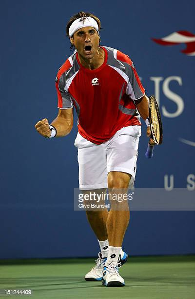 David Ferrer of Spain celebrates match point against Richard Gasquet of France during their men's singles fourth round match on Day Nine of the 2012...