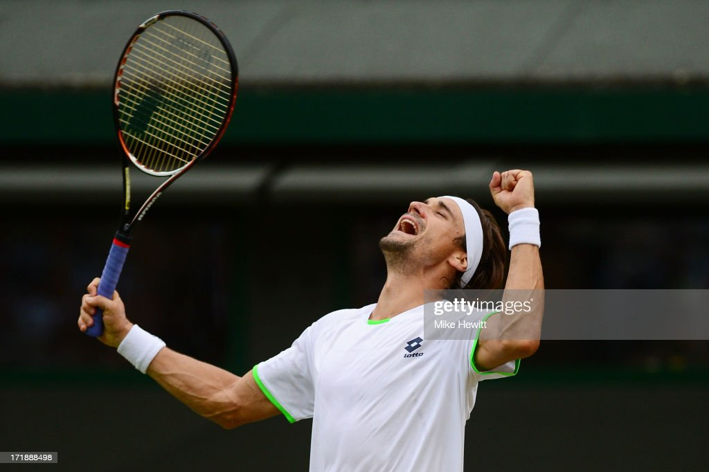 David Ferrer of Spain celebrates match point during the Gentlemen's Singles third round match against Alexandr Dolgopolov of Ukraine on day six of the Wimbledon Lawn Tennis Championships at the All England Lawn Tennis and Croquet Club on June 29, 2013 in London, England.