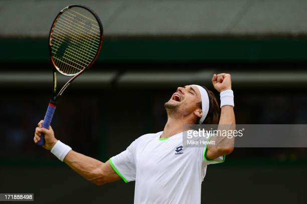 David Ferrer of Spain celebrates match point during the Gentlemen's Singles third round match against Alexandr Dolgopolov of Ukraine on day six of...