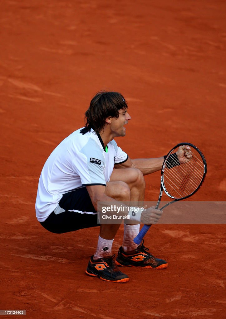 David Ferrer of Spain celebrates match point during the men's singles semi-final match against Jo-Wilfried Tsonga of France on day thirteen of the French Open at Roland Garros on June 7, 2013 in Paris, France.