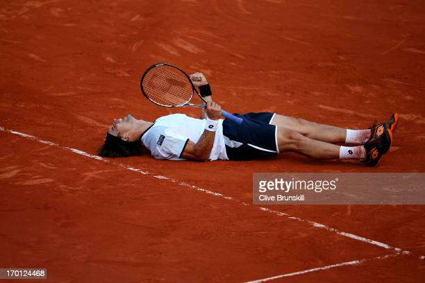 David Ferrer of Spain celebrates match point during the men's singles semifinal match against JoWilfried Tsonga of France on day thirteen of the...