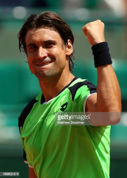David Ferrer of Spain celebrates match point in his Men's Singles match against Kevin Anderson of South Africa during day eight of the French Open at...