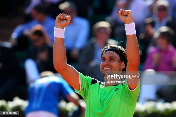 David Ferrer of Spain celebrates match point in his Men's Singles quarter final match against Tommy Robredo of Spain during day ten of the French...