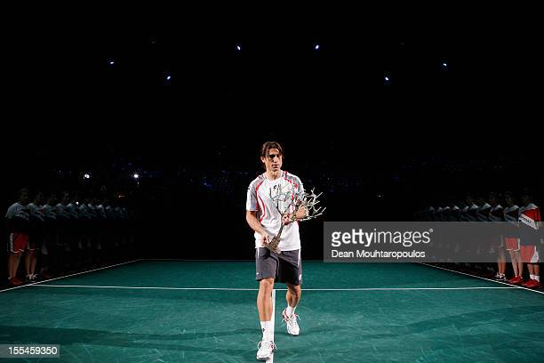 David Ferrer of Spain celebrates victory against Jerzy Janowicz of Poland by holding the Trophy up after the Mens Final on day 7 of the BNP Paribas...