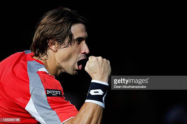 David Ferrer of Spain celebrates victory against Michael Llodra of France in their Semi Final match on day 6 of the BNP Paribas Masters at Palais...
