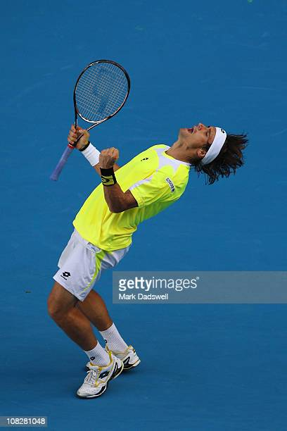 David Ferrer of Spain celebrates winning his fourth round match against Milos Raonic of Canada during day eight of the 2011 Australian Open at...