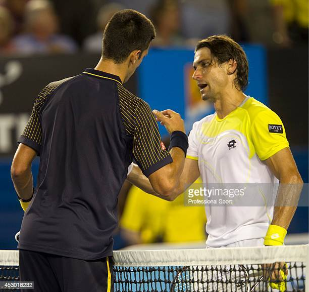 David Ferrer of Spain congratulates Novak Djokovic of Serbia after his victory in their semi-final match on day eleven of the 2013 Australian Open at...