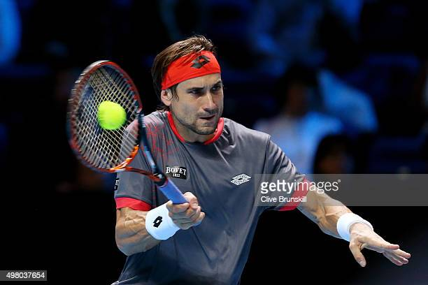 David Ferrer of Spain hits a forehand during the men's singles match against Rafael Nadal of Spain on day six of the Barclays ATP World Tour Finals...