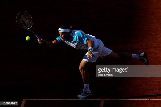 David Ferrer of Spain hits a forehand during the men's singles round four match between David Ferrer of Spain and Gael Monfils of France on day eight...