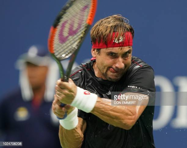 David Ferrer of Spain hits a return to Rafael Nadal of Spain during their 2018 US Open men's Singles match at the USTA Billie Jean King National...