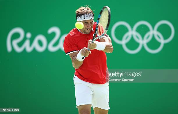 David Ferrer of Spain hits during the men's second round single match against Evgeny Donskoy of Russia on Day 4 of the Rio 2016 Olympic Games at the...