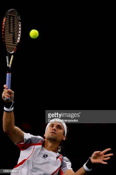 David Ferrer of Spain in action against Marcel Granollers of Spain during day 3 of the BNP Paribas Masters at Palais Omnisports de Bercy on October...