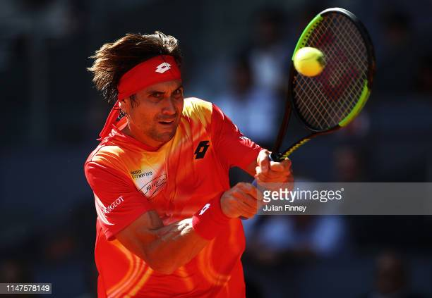 David Ferrer of Spain in action against Roberto Bautista Agut of Spain during day four of the Mutua Madrid Open at La Caja Magica on May 07 2019 in...