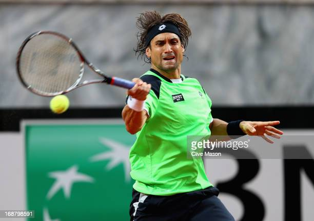 David Ferrer of Spain in action during his second round match against Fernando Verdasco of Spain on day four of the Internazionali BNL d'Italia 2013...