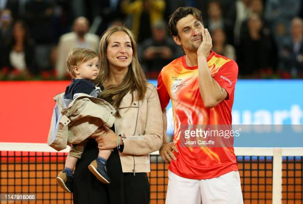 David Ferrer of Spain is joined by his wife Marta Tornel and their son Leo Ferrer during a farewell ceremony following his last match on tour against...
