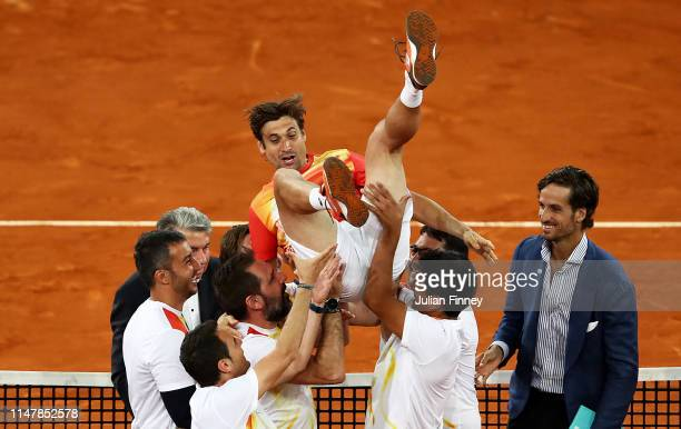 David Ferrer of Spain is tossed in the air after his last ever match during day five of the Mutua Madrid Open at La Caja Magica on May 08 2019 in...