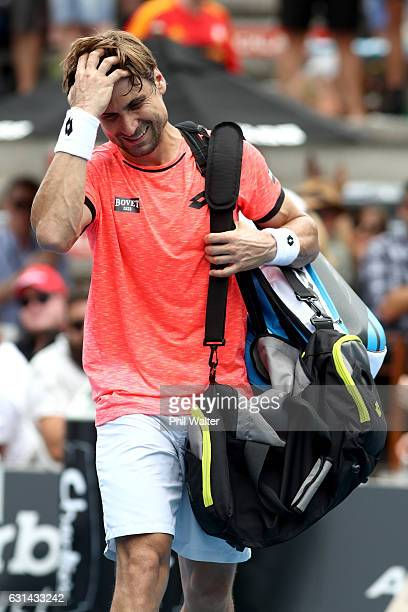 David Ferrer of Spain leaves the court following the mens singles match between Robin Haase of the Netherlands and David Ferrer of Spain on day 10 of...