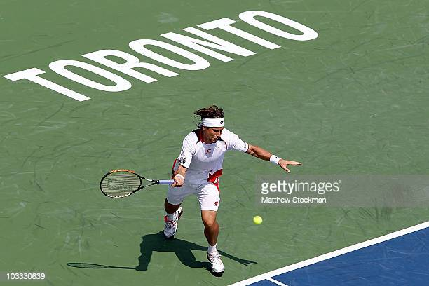David Ferrer of Spain lunges for a ball while playing David Nalbandian of Argentina during the Rogers Cup at the Rexall Centre on August 10, 2010 in...
