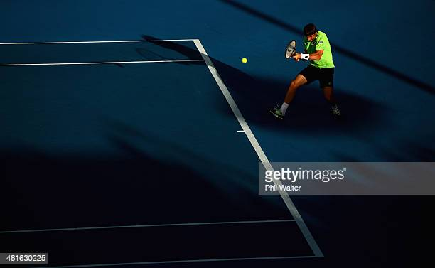 David Ferrer of Spain plays a backhand during his semi final match against YenHsun Lu of Chinese Tapei during day five of the Heineken Open at the...