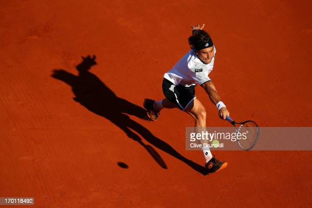 David Ferrer of Spain plays a backhand during the men's singles semi-final match against Jo-Wilfried Tsonga of France on day thirteen of the French...