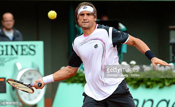 PARIS FRANCE JUNE 04 David Ferrer of Spain plays a backhand in his men's singles fourth round match against Marcel Granollers of Spain during day 9...