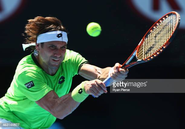 David Ferrer of Spain plays a backhand in his third round match against Jeremy Chardy of France during day five of the 2014 Australian Open at...