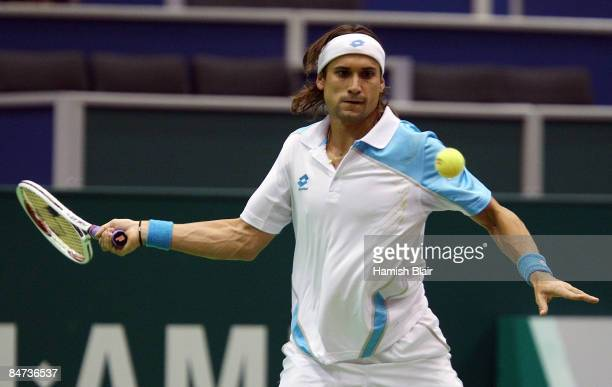 David Ferrer of Spain plays a forehand during his match against Mikhail Youzhny of Russia during day three of the ABN AMRO World Tennis Tournament at...