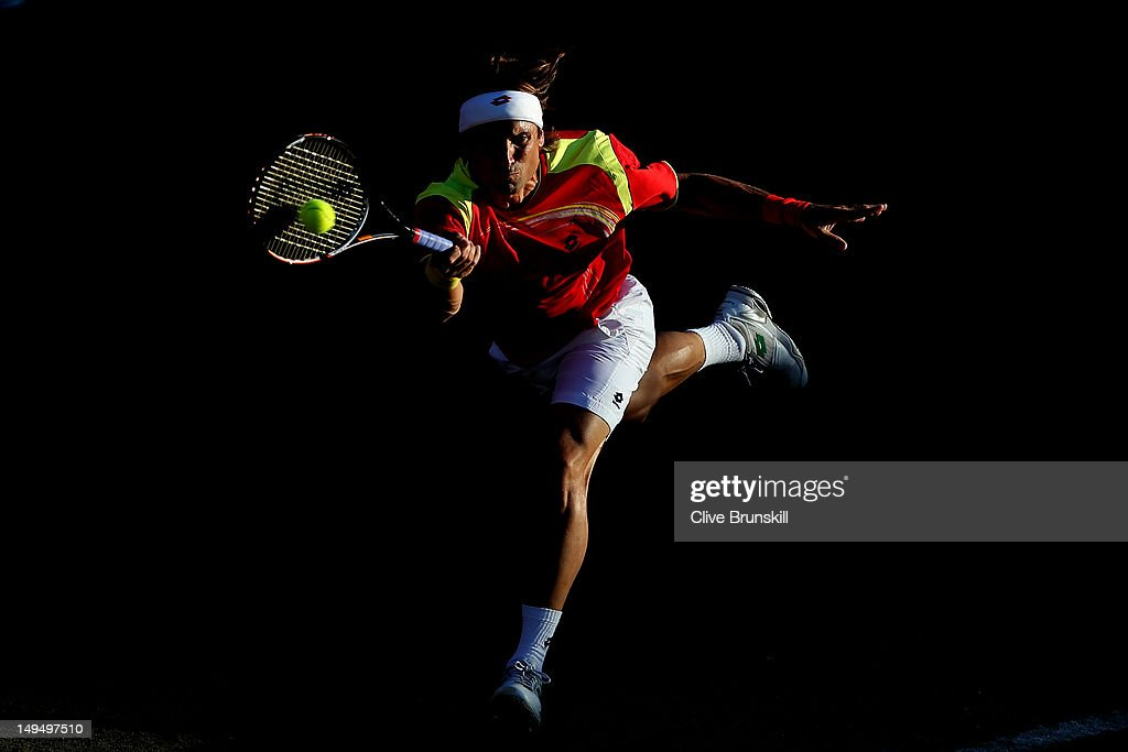 David Ferrer of Spain plays a forehand during the Men's Singles Tennis match against Vasek Pospisil of Canada on Day 2 of the London 2012 Olympic Games at the All England Lawn Tennis and Croquet Club in Wimbledon on July 29, 2012 in London, England.