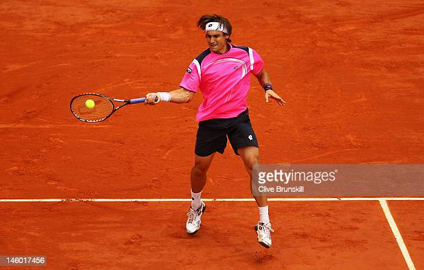 David Ferrer of Spain plays a forehand in his men's singles semi final match against Rafael Nadal of Spain during day 13 of the French Open at Roland...