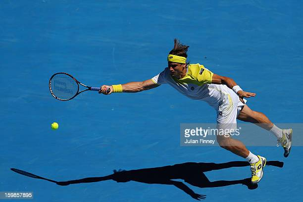 David Ferrer of Spain plays a forehand in his Quarterfinal match against Nicolas Almagro of Spain during day nine of the 2013 Australian Open at...