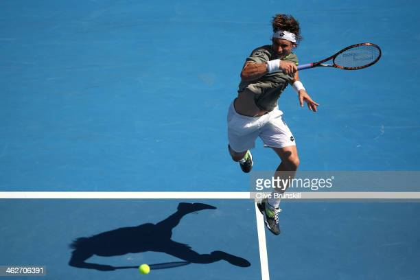 David Ferrer of Spain plays a forehand in his second round match against Adrian Mannarino of France during day three of the 2014 Australian Open at...