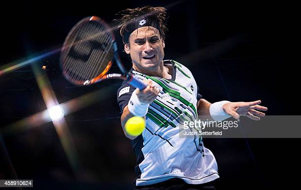 David Ferrer of Spain plays a forehand in the round robin singles match against Kei Nishikori of Japan on day five of the Barclays ATP World Tour...