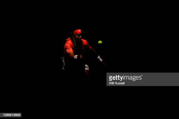 David Ferrer of Spain plays a forehand Lucas Pouille of France during day seven of the 2019 Hopman Cup at Perth Arena on January 04 2019 in Perth...