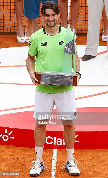 David Ferrer of Spain poses for a photo with the trophy after winning the final match against Fabio Fognini of Italy as part of ATP Buenos Aires Copa...