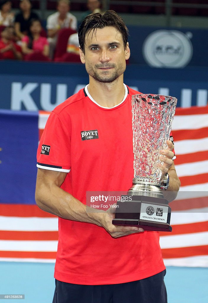 David Ferrer of Spain poses with his trophy after defeating Feliciano Lopez of Spain 7-5 7-5 during the 2015 ATP Malaysian Open at Bukit Jalil National Stadium on October 4, 2015 in Kuala Lumpur, Malaysia.