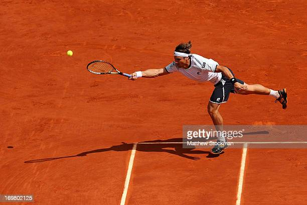 David Ferrer of Spain reaches for a forehand in his Men's Singles match against Kevin Anderson of South Africa during day eight of the French Open at...