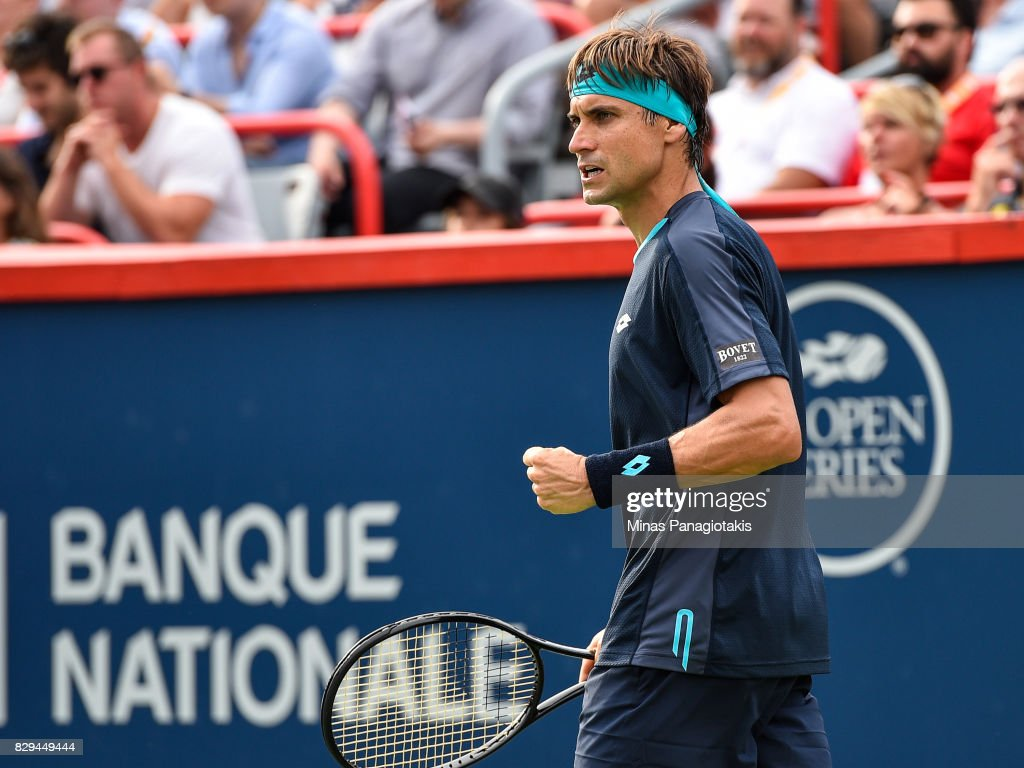 David Ferrer of Spain reacts after scoring a point against Roger Federer of Switzerland during day seven of the Rogers Cup presented by National Bank at Uniprix Stadium on August 10, 2017 in Montreal, Quebec, Canada.