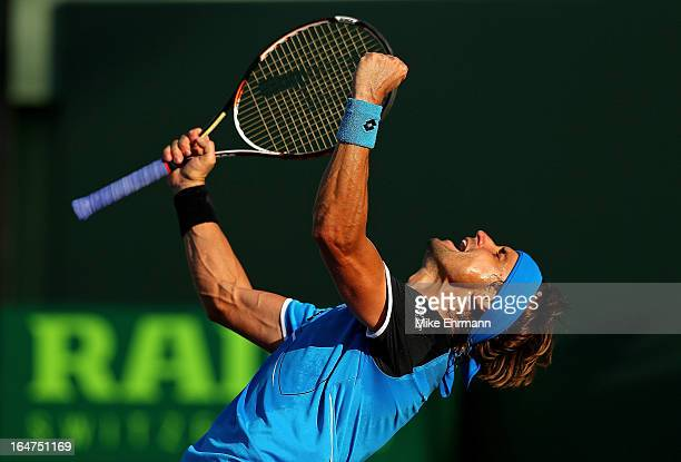 David Ferrer of Spain reacts after winning a match against Jurgen Melzer of Austria during Day 10 of the Sony Open at Crandon Park Tennis Center on...