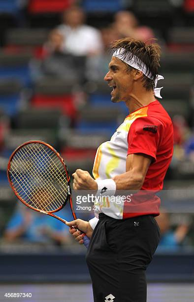 David Ferrer of Spain reacts after winning his match against Andy Murray of Great Britain during the day 5 of the Shanghai Rolex Masters at the Qi...