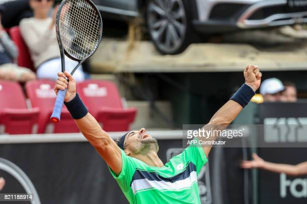 David Ferrer of Spain reacts after winning the singles final match of the Swedish Open ATP tennis tournament against Alexandr Dolgopolov of Ukraine...